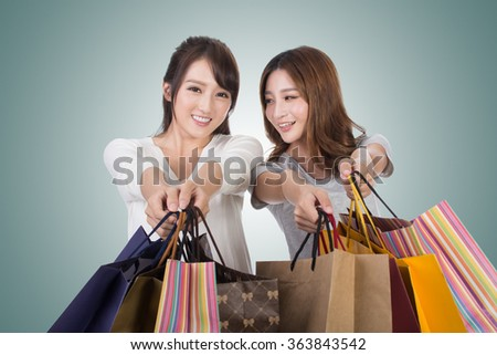 Asian shopping woman with her friends holding bags. - stock photo