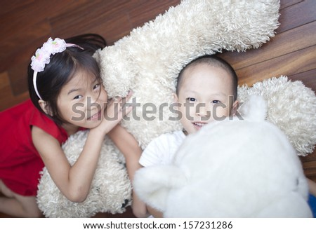 Asian sister and brother playing at home