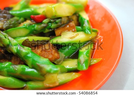 Asian stir fried asparagus cooked with various vegetable ingredients. Suitable for food and beverage, healthy lifestyle, and diet and nutrition. - stock photo