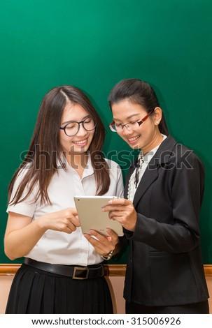 Asian student and teacher in clasroom,Bangkok Thailand - stock photo
