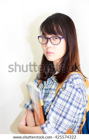 Asian student girl is holding her English book with white background.