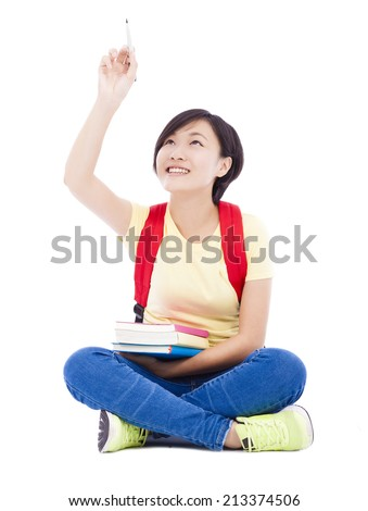 asian student girl sitting  and drawing over white background - stock photo