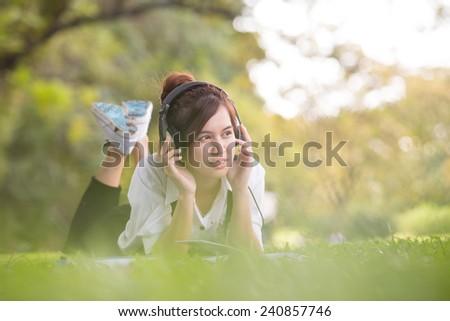 Asian student in park of Bangkok Thailand - stock photo