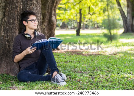 Asian student in park of Bangkok Thailand - stock photo