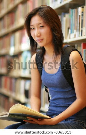 asian student reading - stock photo