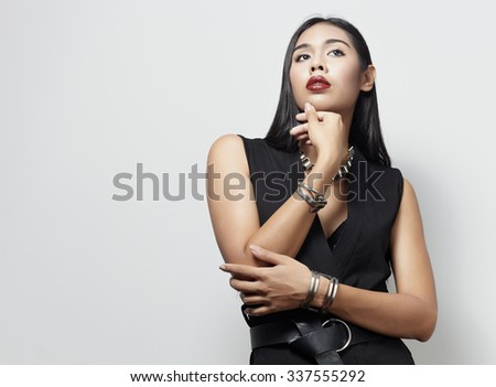 Asian style fashion model in the studio against white wall - stock photo