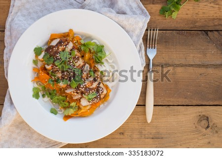 Asian style roasted chicken with vegetables on wooden table - stock photo