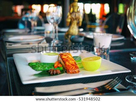 Asian style salmon steak on restaurant table