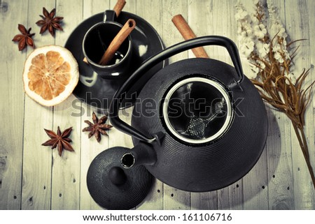 Asian tea set (Green tea, orange, anise, cinnamon) - stock photo