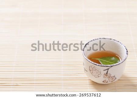 Asian tea set on bamboo mat,Closeup.  - stock photo