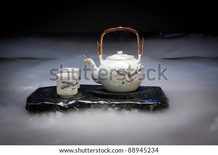 asian  tea set with fog