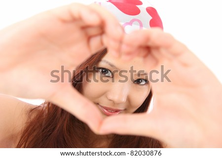 Asian teen makes the heart - stock photo