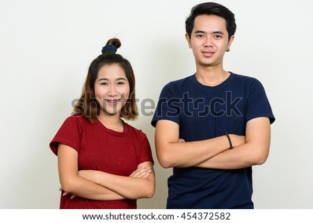 Asian teenage couple smiling - stock photo