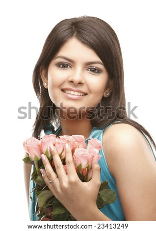 asian teenage girl with lovely pink roses - stock photo