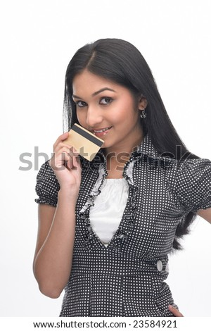 Asian teenage girl with the credit card - stock photo