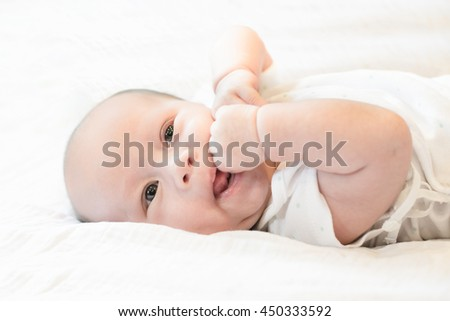 Asian Thai baby infant are happy on the bed with baby smile face - stock photo