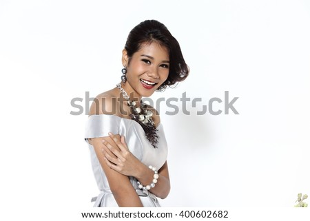 Asian Thai Female Model with Tan Skin on Fashion Make Up with Studio Lighting on White Background, silver outfit