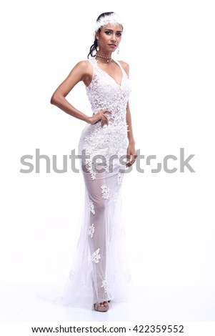 Asian Thai India Female Woman Model Tan Skin in Lace See Through White Evening Gown with Tiara and High Heel, Fashion Make Up, Studio Lighting on White Background, ho so lady smart healthy concept