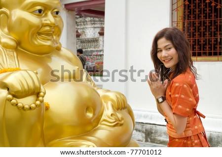 asian thai woman praying big buddha golden statue in wat arun temple, Thailand - stock photo