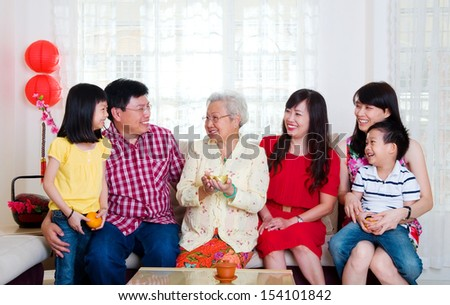 Asian three generations family celebrating chinese new year - stock photo