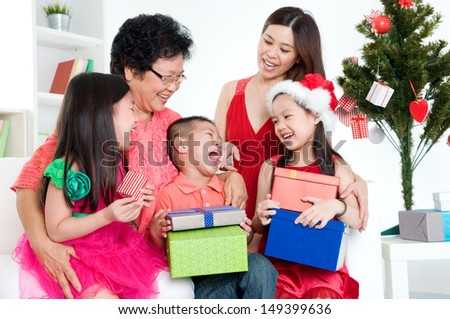 Asian three generations family celebrating christmas - stock photo