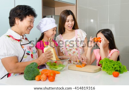 Asian three generations family enjoyed cooking in the kitchen - stock photo