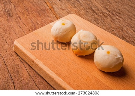 Asian Traditional Dessert, Chinese Cake, Moon Cake, Thai Cake or Chinese Pastry. Filled with Bean Paste and Egg Yolk. Delicious Dessert. / On Wood Background. - stock photo