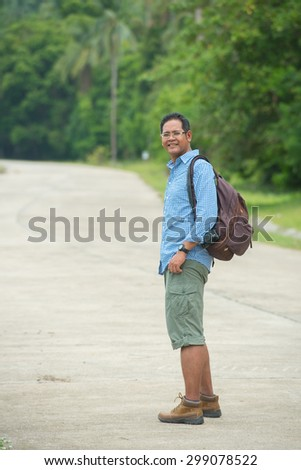 Asian traveler with backpack