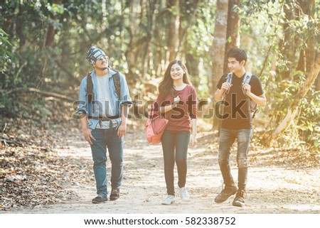 Asian traveler with friends, Group backpacks young walking together and looking happy