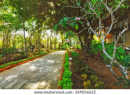 asian tropical garden with traditional architecture, Vietnam - stock photo