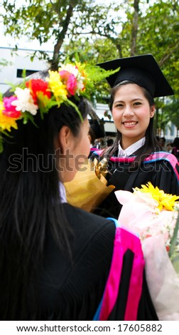 Asian university graduates celebrating their success. - stock photo