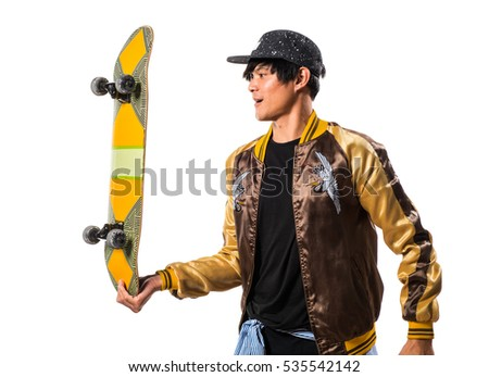 Asian urban man with skate