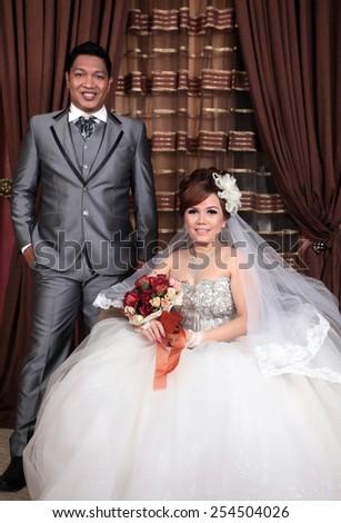 Asian wedding couple indoor - stock photo