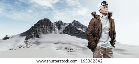 Asian winter sport fashion man in snow mountain landscape. Wearing brown jacket and brown trousers. - stock photo