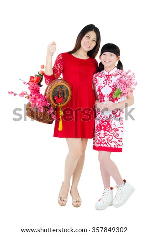 Asian woman and daughter holding gift box and flower, chinese new year concept.