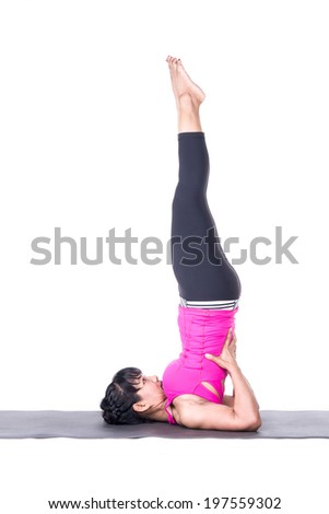 Asian woman beautiful yoga posing on a studio white background, woman in white stand on spine isolated.woman stand on neck - doing yoga asana.Yong woman doing yoga - sarvangasana isolated - stock photo