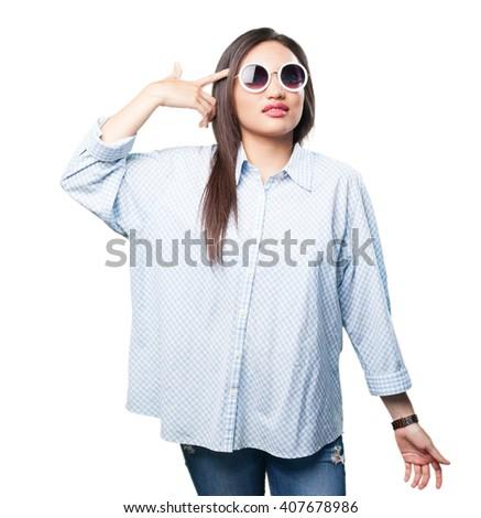 asian woman doing gun gesture - stock photo