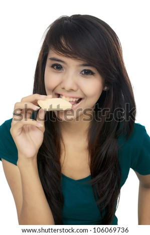 Asian woman eat wafer isolated over white background