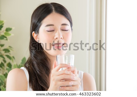 asian woman enjoy the freshness of clean water from perfect environment indoor