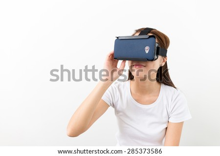 Asian Woman experience virtual reality on a mobile phone - stock photo