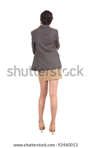 Asian woman from the back, looking at something isolated - stock photo