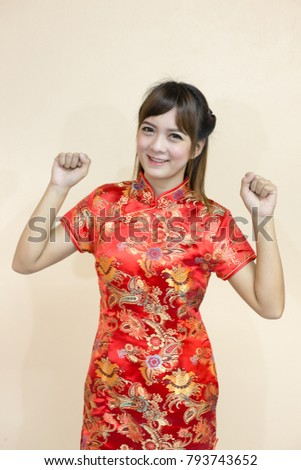 Asian woman greeting traditional chinese cheongsam stock photo safe asian woman greeting in traditional chinese or cheongsam with hand lift welcome expression and lucky and m4hsunfo