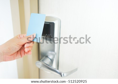 Asian Woman Hand Holds Card For Door Access Control Scanning Key Card To  Lock And Unlock