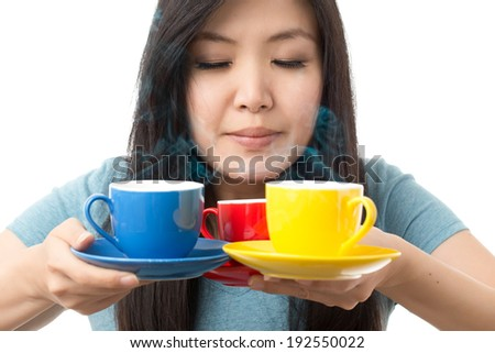 asian woman having a coffee shooting on white background - stock photo