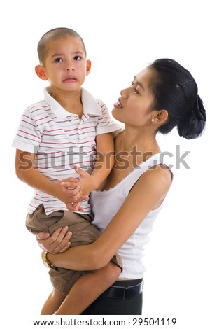 asian woman holding a cute crying boy - stock photo