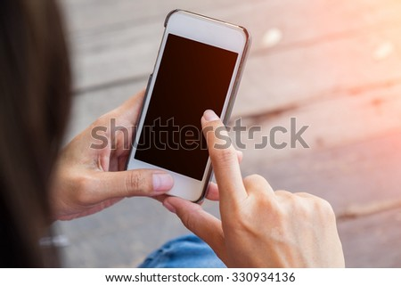 Asian woman holding a empty screen of smart phone. for on-line shopping.selective focus.