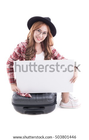 Asian woman holding a white board with a suitcase on white background.