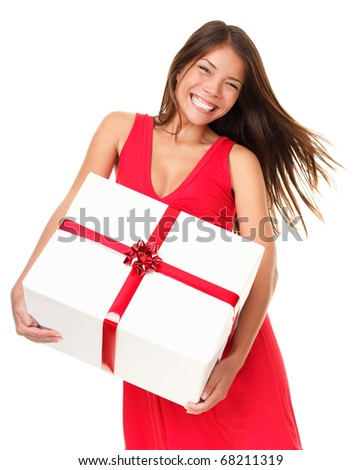 Asian woman holding big gift happy and excited. Isolated on white background. - stock photo