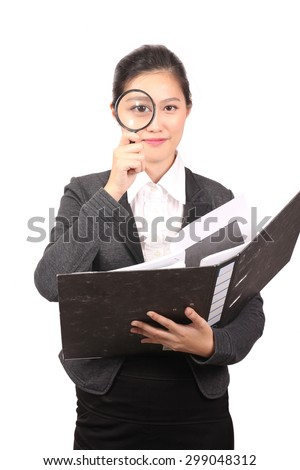Asian woman holding file with magnifying glass - stock photo