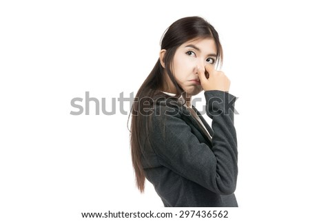 Asian woman holding her nose because of a very bad smell,something stinks,Thai girl,isolated on white background - stock photo